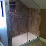 This corner shower only needs one side to be glass, using three walls to enclose the shower